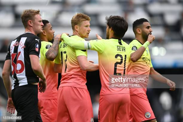 Manchester City's Spanish midfielder David Silva congratulates Manchester City's Belgian midfielder Kevin De Bruyne after he scored the opening goal...