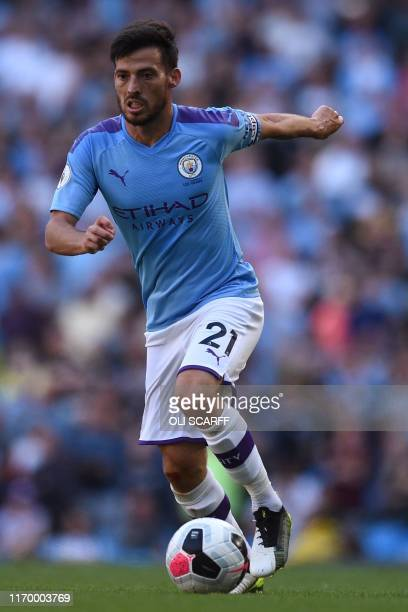 Manchester City's Spanish midfielder David Silva controls the ball during the English Premier League football match between Manchester City and...