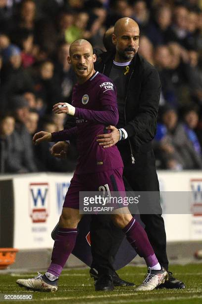 Manchester City's Spanish midfielder David Silva is substituted by Manchester City's Spanish manager Pep Guardiola during the English FA Cup fifth...