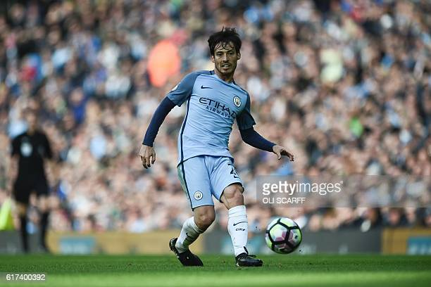 Manchester City's Spanish midfielder David Silva passes the ball during the English Premier League football match between Manchester City and...