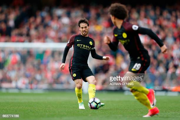 Manchester City's Spanish midfielder David Silva passes the ball during the English Premier League football match between Arsenal and Manchester City...