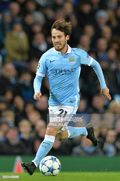 Manchester City's Spanish midfielder David Silva runs with the ball during the UEFA Champions League Group D football match between Manchester City...