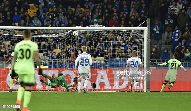 Manchester City's Spanish midfielder David Silva scores during the UEFA Champions league round of 16 first leg football match FC Dynamo Kyiv vs...