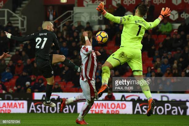 Manchester City's Spanish midfielder David Silva shoots past Stoke City's English goalkeeper Jack Butland to score his second goal during the English...
