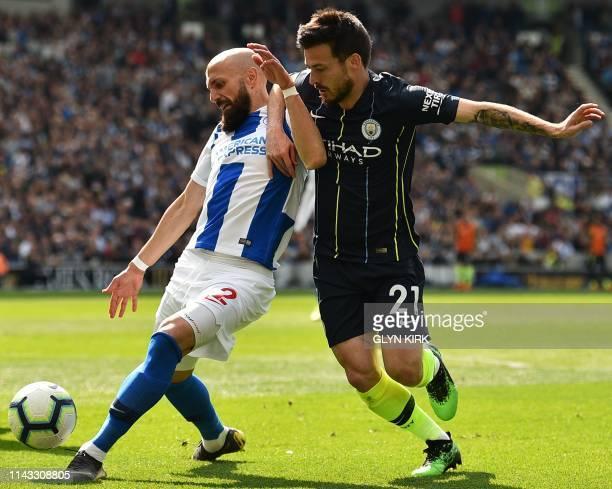 Manchester City's Spanish midfielder David Silva takes on Brighton's Spanish defender Bruno Saltor during the English Premier League football match...