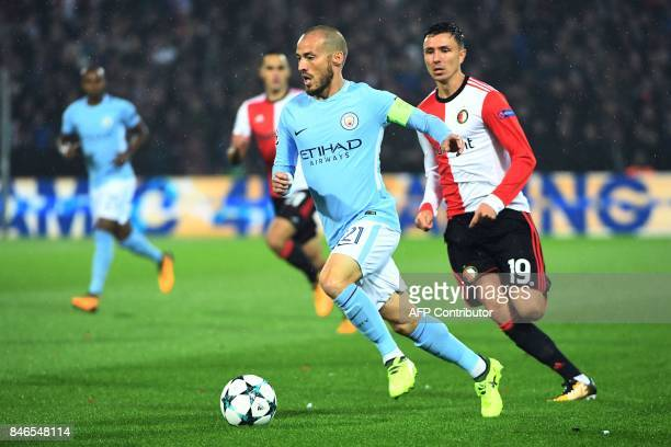 Manchester City's Spanish midfielder David Silva vies for the ball with Feyenoord's Dutch striker Steven Berghuis during the UEFA Champions League...
