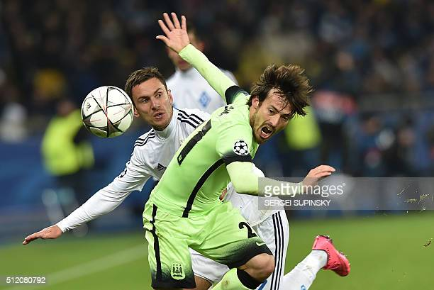 TOPSHOT Manchester City's Spanish midfielder David Silva vies with Dynamo Kiev's Ukrainian midfielder Serhiy Rybalka during the UEFA Champions league...