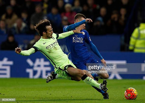 Manchester City's Spanish midfielder David Silva vies with Leicester City's English striker Jamie Vardy during the English Premier League football...
