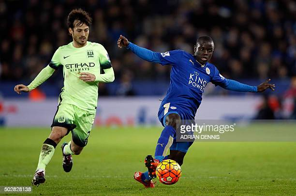 Manchester City's Spanish midfielder David Silva vies with Leicester City's French midfielder N'Golo Kante during the English Premier League football...