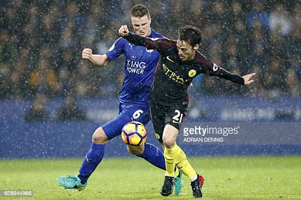 Manchester City's Spanish midfielder David Silva vies with Leicester City's German defender Robert Huth during the English Premier League football...