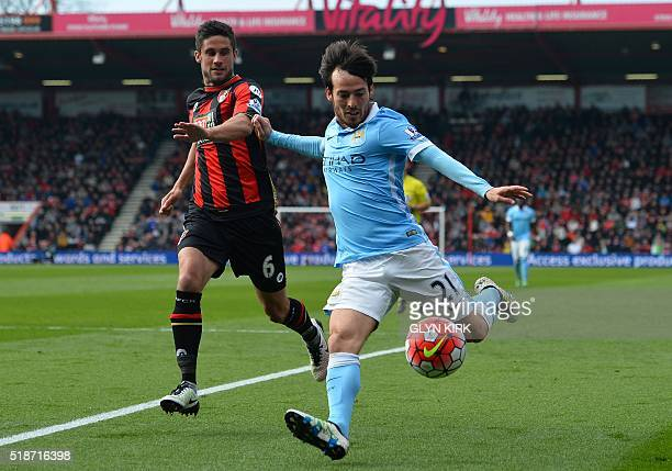 Manchester City's Spanish midfielder David Silva vies with Bournemouth's South African-born English midfielder Andrew Surman during the English...