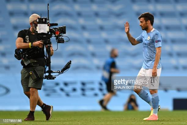 Manchester City's Spanish midfielder David Silva waves into the lens of a television camera operator after the UEFA Champions League round of 16...