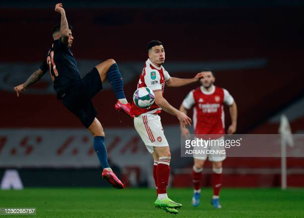 Manchester City's Spanish midfielder Ferran Torres challenges Arsenal's Brazilian striker Gabriel Martinelli during the English League Cup quarter...