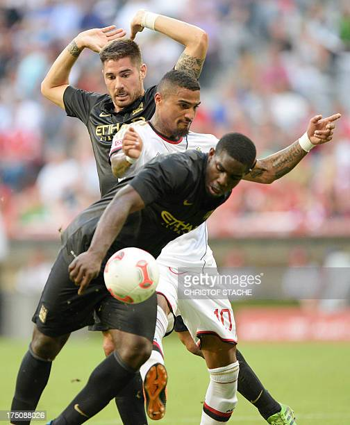 Manchester City's Spanish midfielder Javi Garcia Milan's German midfielder KevinPrince Boateng and Manchester City's English defender Micah Richards...
