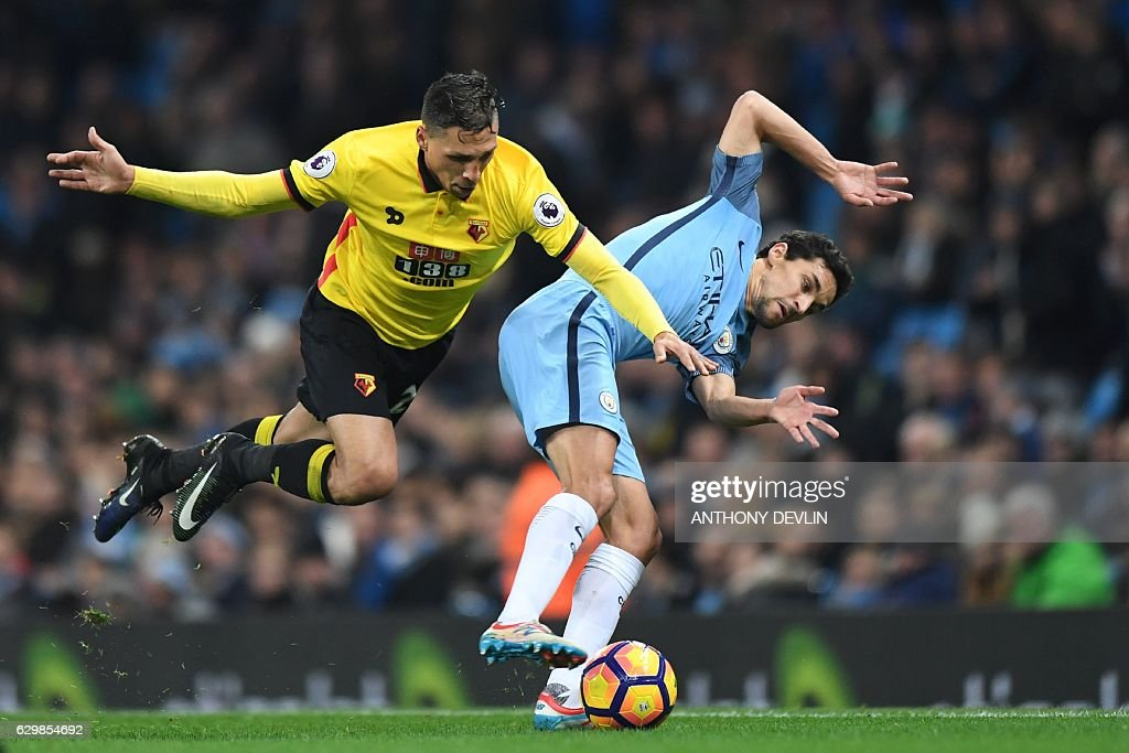 TOPSHOT - Manchester City's Spanish midfielder Jesus Navas (R) tangles with Watford's German-born Greek midfielder José Holebas (L) during the English Premier League football match between Manchester City and Watford at the Etihad Stadium in Manchester, north west England, on December 14, 2016. / AFP / Anthony DEVLIN / RESTRICTED TO EDITORIAL USE. No use with unauthorized audio, video, data, fixture lists, club/league logos or 'live' services. Online in-match use limited to 75 images, no video emulation. No use in betting, games or single club/league/player publications. /