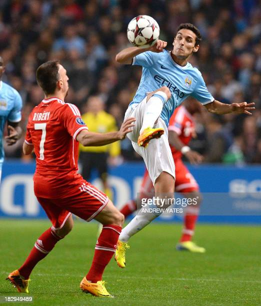 Manchester City's Spanish midfielder Jesus Navas vies with Bayern Munich's French midfielder Franck Ribery during the UEFA Champions League group D...