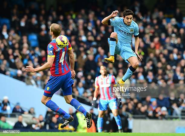 Manchester City's Spanish midfielder Jesus Navas vies with Crystal Palace's USborn Norwegian defender Brede Hangeland during the English Premier...