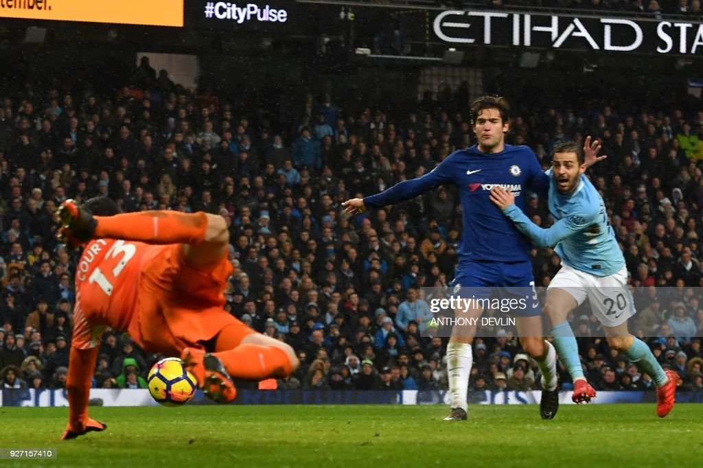 Manchester City's Spanish midfielder Manuel Garcia Alonso (C) takes a chance at goal during the English Premier League football match between Manchester City and Chelsea at the Etihad Stadium in Manchester, north west England on March 4, 2018. / AFP PHOTO / Anthony Devlin / RESTRICTED TO EDITORIAL USE. No use with unauthorized audio, video, data, fixture lists, club/league logos or 'live' services. Online in-match use limited to 75 images, no video emulation. No use in betting, games or single club/league/player publications. /