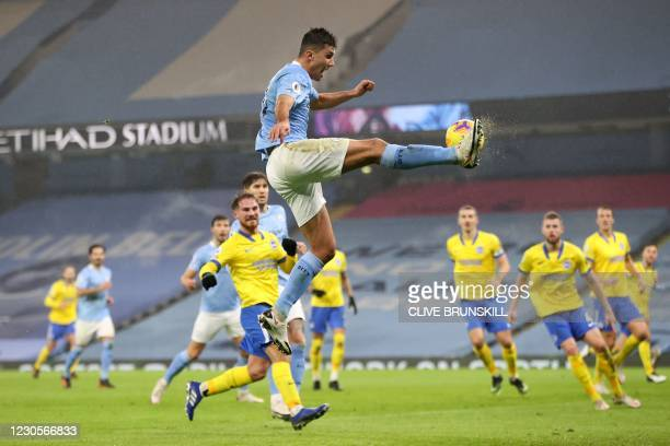 Manchester City's Spanish midfielder Rodrigo jumps up to kick the ball during the English Premier League football match between Manchester City and...