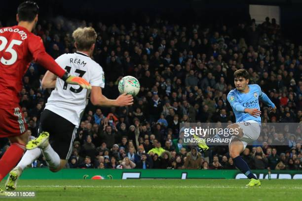 Manchester City's Spanishborn midfielder Brahim Diaz shoots to score their second goal during the English League Cup 4th round football match between...