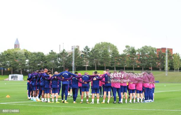 Manchester City's squad pay respects with a moment of silence for the people affected by the terror attacks in Barcelona during training at...