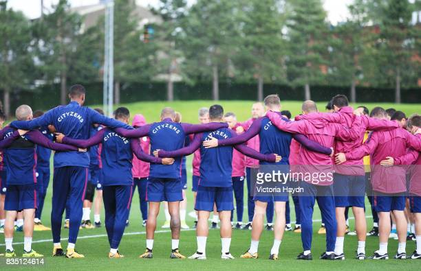 Manchester City's squad take part in a moments silence to pay respect to the people injured in the Barcelona terror attacks during training at...