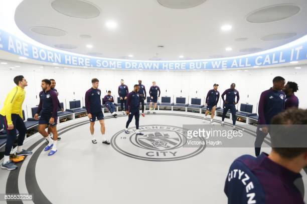 Manchester City's squad visit their newly renovated dressing room for the first time at Etihad Stadium on August 19 2017 in Manchester England