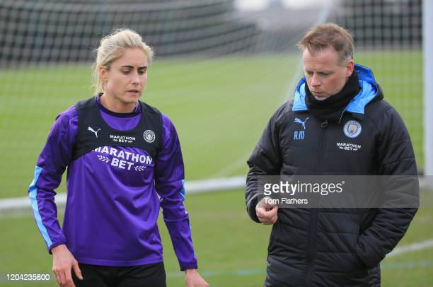Manchester City's Steph Houghton and Alan Mahon in action during training at Manchester City Football Academy on February 05 2020 in Manchester...