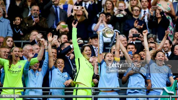 Manchester City's Steph Houghton celebrates winning the FA Cup with her teammates