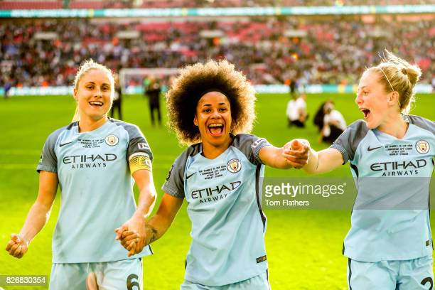 Manchester City's Steph Houghton Demi Stokes and Keira Walsh celebrate winning the FA Cup