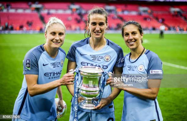 Manchester City's Steph Houghton Jill Scott and Cari Lloyd celebrate winning the FA Cup