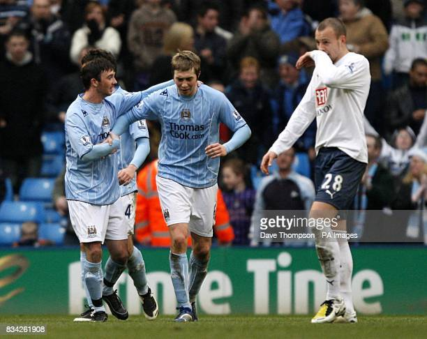 Manchester City's Stephen Ireland celebrates with team mate Michael Johnson after scoring the second goal of the game as Tottenham Hotspur's Alan...