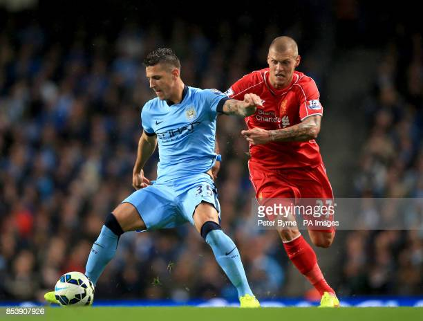 Manchester City's Stevan Jovetic and Liverpool's Martin Skrtel battle for the ball during the Barclays Premier League match at the Etihad Stadium...