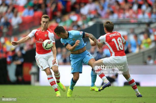 Manchester City's Stevan Jovetic battles for the ball with Arsenal's Calum Chambers and Nacho Monreal during the Community Shield match at Wembley...