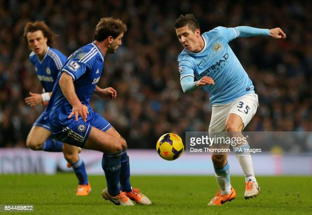 Manchester City's Stevan Jovetic battles for the ball with Chelsea's Branislav Ivanovic during the Barclays Premier League match against Chelsea at...