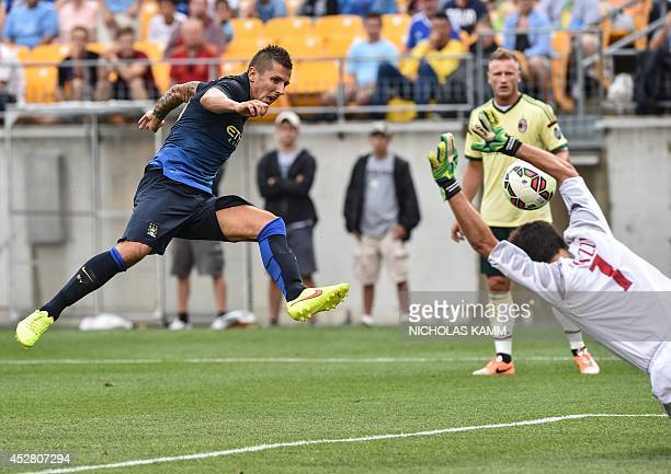 Manchester City's Stevan Jovetic scores past AC Milan goalkeeper Michael Agazzi during a Champions Cup match at Heinz Field in Pittsburgh on July 27...
