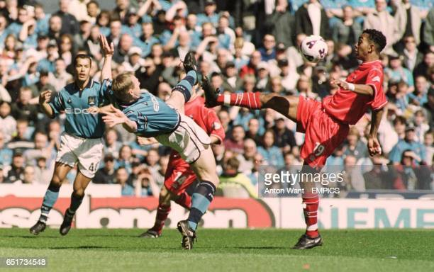Manchester City's Stuart Pearce and Barnsley's Kevin Betsy battle for the ball