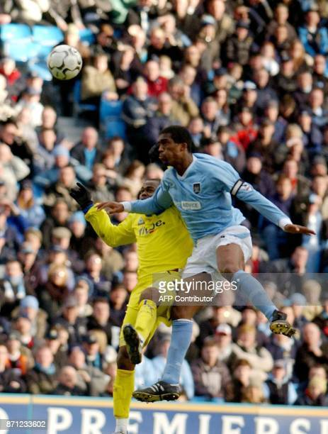 Manchester City's Sylvian Distin beats Birminghams Stern John in the air during today's premiereship clash at The City of Manchester Stadium 08...