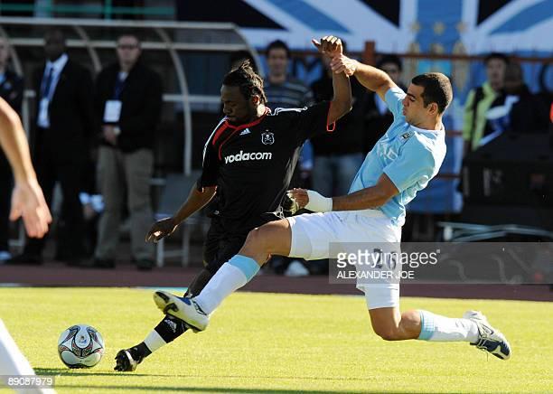 Manchester City's Tal Ben Haim tries to block Orlando Pirates' Siphelele Mtllembu during their 2009 Vodacom Challenge football match at Peter Mokaba...