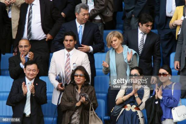 Manchester City's Thaksin Shinawatra and wife Pojaman in the stands with adviser Pairoj Piempongsant agent Kia Joorabchian and private financier...