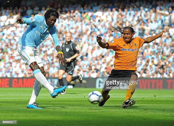Manchester City's Togolese striker Emmanuel Abebayor scores the opening goal of the English Premier League football match between Manchester City and...