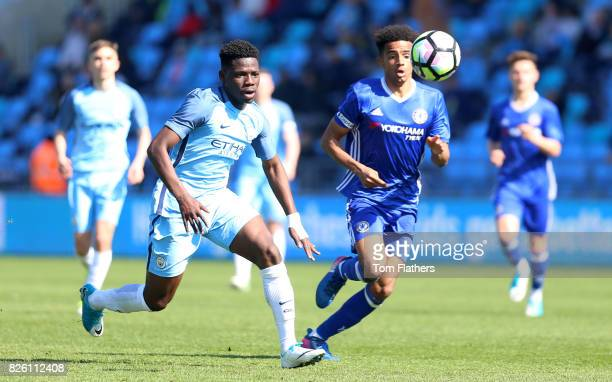 Manchester City's Tom Dele Bashiru in action against Chelsea
