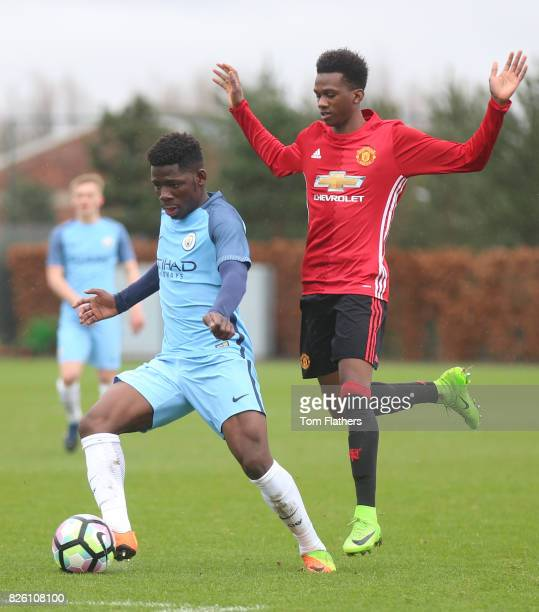Manchester City's Tom Dele Bashiru in action against Manchester United's Joshua Bohui