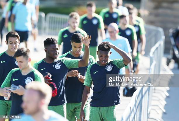Manchester City's Tom DeleBashiru Rabbi Matondo and Cameron Humphreys walk to training at University of Illinois on July 18 2018 in Chicago Illinois