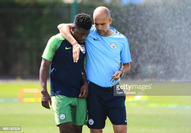 Manchester City's Tom DeleBashiru with manager Pep Guardiola during training at Manchester City Football Academy on July 10 2018 in Manchester England