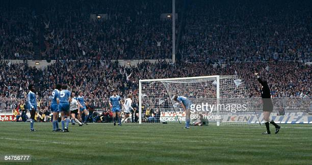 Manchester City's Tommy Hutchison has deflected Glenn Hoddle's shot past Joe Corrigan for Tottenham Hotspur's equalising goal as referee Keith...