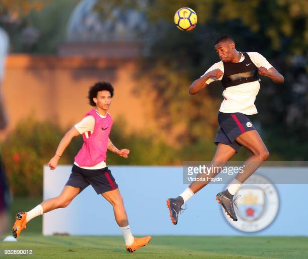 Manchester City's Tosin Adarabioyo and Leroy Sane during the training session on March 16 2018 in Abu Dhabi United Arab Emirates