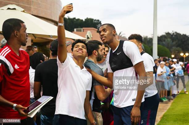 Manchester City's Tosin Adarabioyo interacts with fans during the training session on March 16 2018 in Abu Dhabi United Arab Emirates