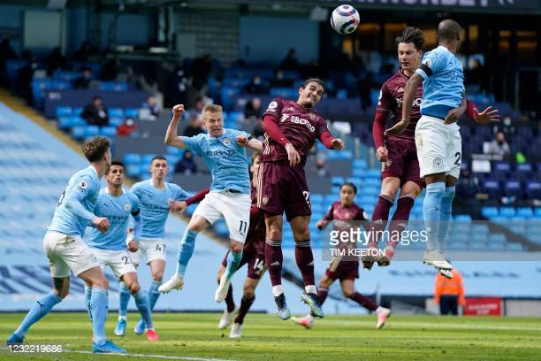 Manchester City's Ukrainian midfielder Oleksandr Zinchenko fights for the ball with Leeds United's Dutch defender Pascal Struijk during the English...