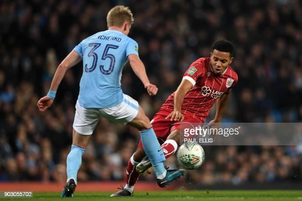 Manchester City's Ukrainian midfielder Oleksandr Zinchenko vies with Bristol City's English midfielder Korey Smith during the English League Cup...